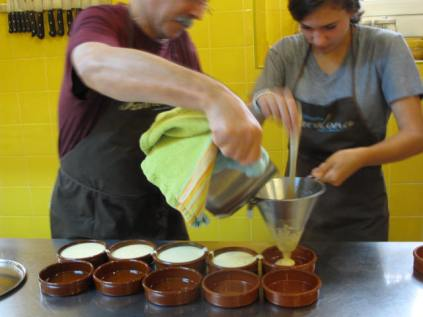Carefully strain steaming Catalan cream into bowls