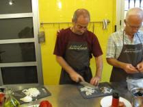 Intently slicing fish