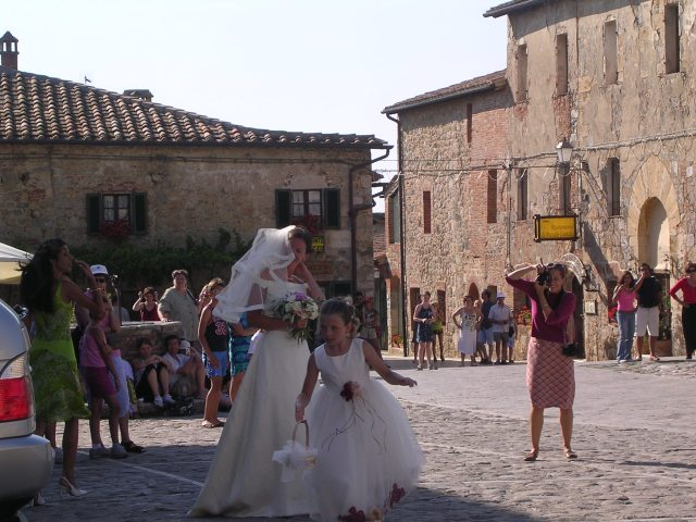 Bride and flower girl, Monteriggioni, Italy