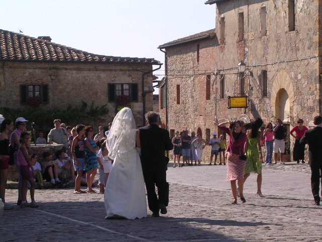 Bride and her father walk into the church, Monteriggioni, Italy