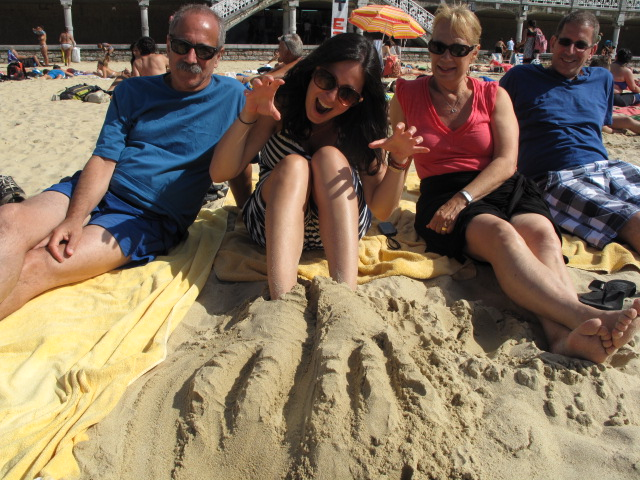 Dinosaur feet, thanks to brother, on beach in San Sebastian, Spain...yes, fun and life-affirming!