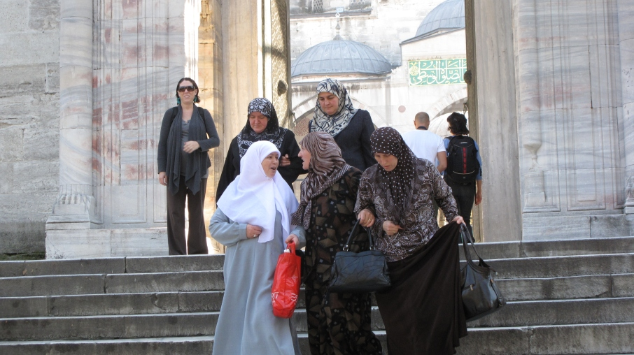 Women wearing hijab, leaving Mosque, carrying Esprit bag...East meets West