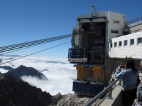 Cable car leaving top of the clouds