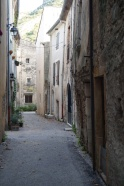 Narrow street between stone houses in St. Jean de Buèges